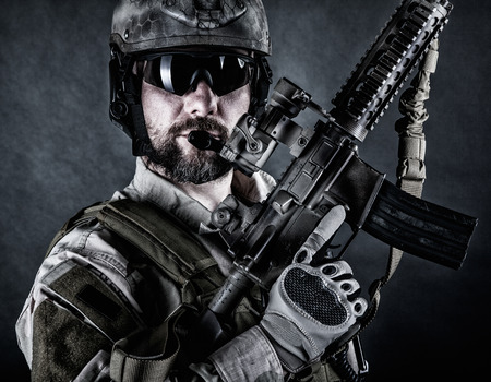 ranger: Bearded special forces soldier on dark background Stock Photo