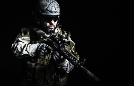 Bearded special forces soldier on dark background 免版税图像