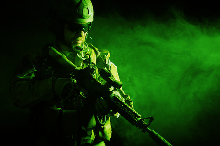 Bearded special forces soldier on dark background Foto de archivo