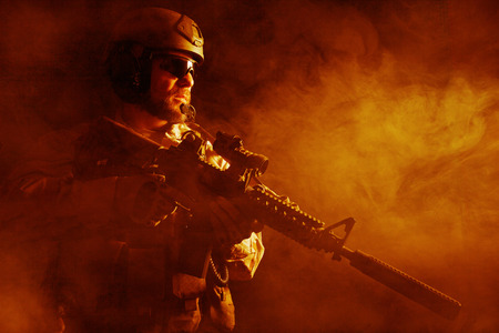 special forces: Bearded special forces soldier on dark background Stock Photo