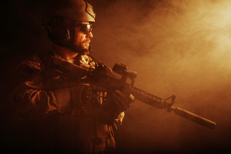 armed forces: Bearded special forces soldier on dark background Stock Photo