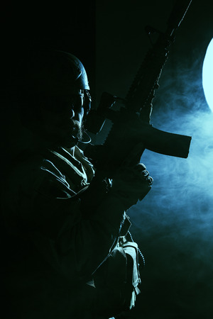 Bearded special forces soldier on dark background 写真素材