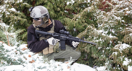 assault rifle: Private military contractor PMC with assault rifle in the winter forest