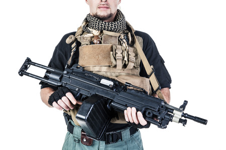 special agent: Studio shot of private military contractor PMC with assault rifle