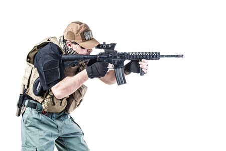 private security: Studio shot of private military contractor PMC with assault rifle