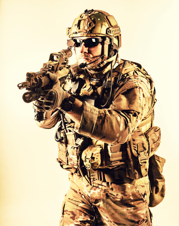 Bearded special warfare operator with assault rifle