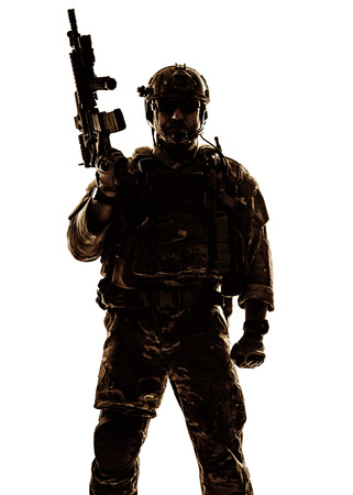 military forces: Silhouette of special warfare operator with assault rifle Stock Photo