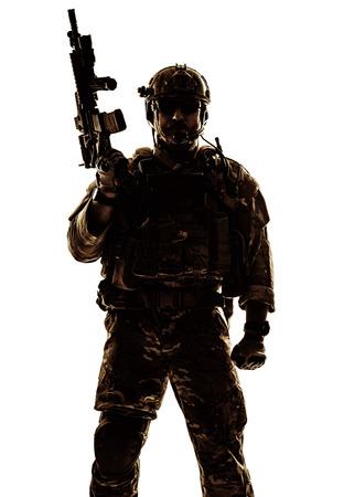 Silhouette of special warfare operator with assault rifle Foto de archivo
