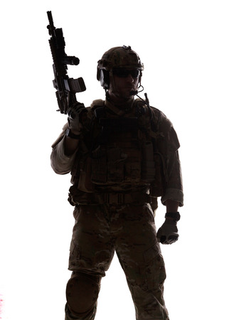 army soldier: Silhouette of special warfare operator with assault rifle Stock Photo