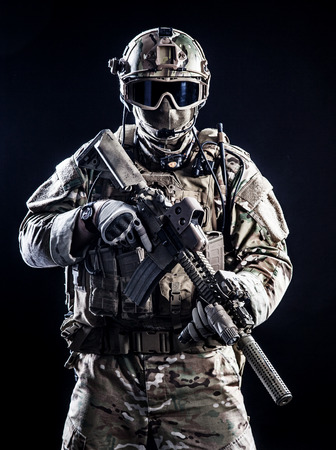 Special forces soldier with rifle on dark background Stok Fotoğraf - 35097699