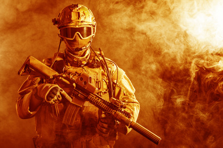 Special forces soldier with rifle in the fire Reklamní fotografie - 35097702