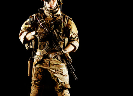 assault rifle: United States Army ranger with assault rifle on dark background
