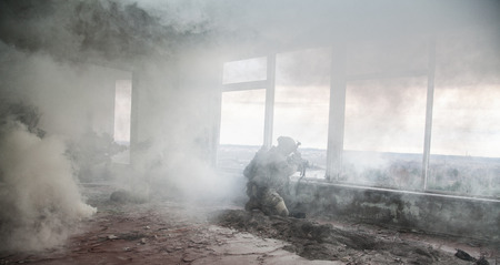 army helmet: United States Army rangers during the military operation in the smoke and fire Stock Photo