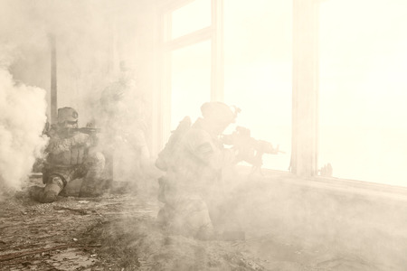 regiment: United States Army rangers during the military operation in the smoke and fire Stock Photo