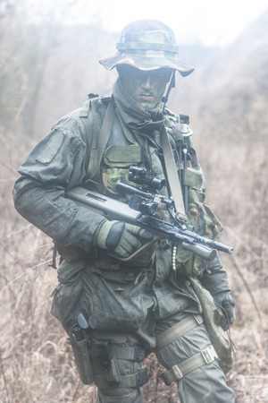 raid: Jagdkommando soldier Austrian special forces equipped with assault rifle during the raid