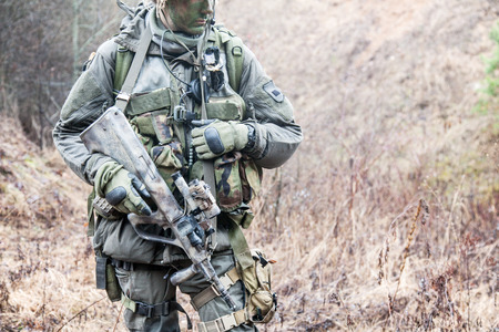 german handgun: Jagdkommando soldier Austrian special forces equipped with assault rifle during the raid