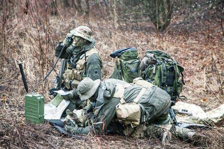 evacuating: Group of jagdkommando soldiers Austrian special forces evacuating the wounded soldier Stock Photo