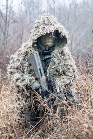 german handgun: Jagdkommando soldier Austrian special forces wearing a ghillie suit Stock Photo