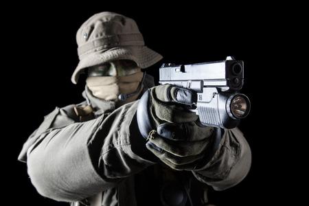 german handgun: Jagdkommando soldier Austrian special forces with pistol on dark background