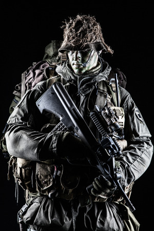 german handgun: Jagdkommando soldier Austrian special forces with rifle on dark background