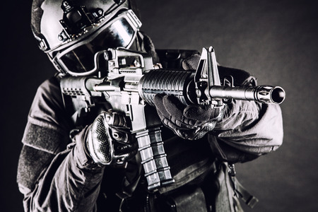 anti nato: Spec ops police officer SWAT in black uniform and face mask Stock Photo