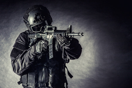 policeman: Spec ops police officer SWAT in black uniform and face mask Stock Photo