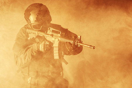 anti nato: Spec ops police officer SWAT in the smoke and fire Stock Photo
