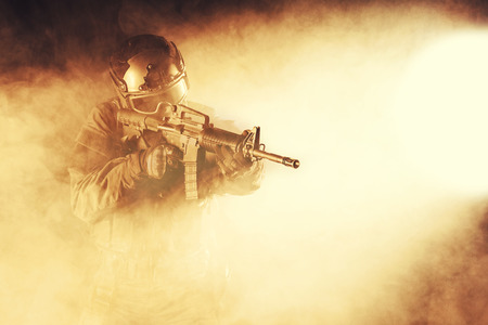 police force: Spec ops police officer SWAT in the smoke and fire Stock Photo