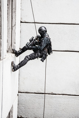 spec: Spec ops police officer SWAT during rope exercises with weapons Stock Photo