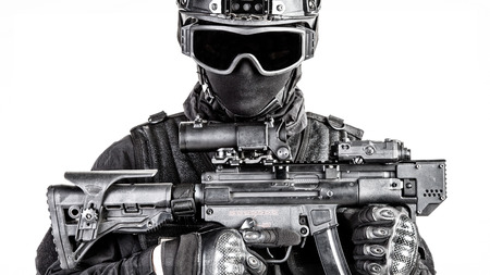 ops: Spec ops police officer SWAT in black uniform and face mask Stock Photo