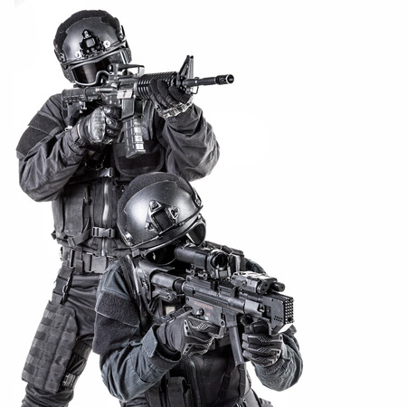 us: Spec ops police officer SWAT in black uniform and face mask Stock Photo