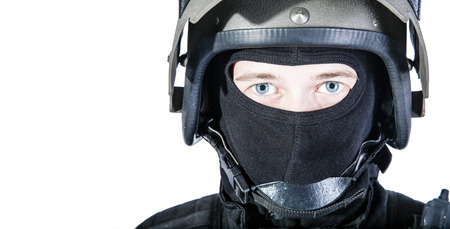 Russian special forces operator in black uniform and bulletproof helmet Stock Photo
