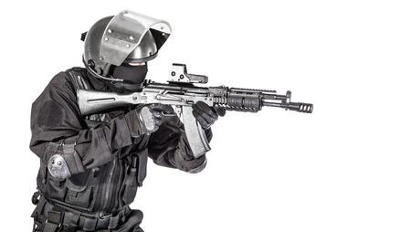 Russian special forces operator in black uniform and bulletproof helmet Stok Fotoğraf