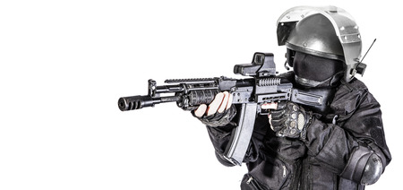 special operations: Russian special forces operator in black uniform and bulletproof helmet Stock Photo