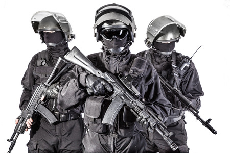 police unit: Russian special forces operators in black uniform and bulletproof helmets