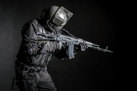 assault forces: Russian special forces operator in black uniform and bulletproof helmet Stock Photo