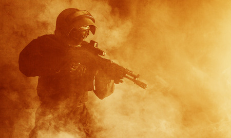 bulletproof vest: Russian special forces operator in bulletproof helmet in the smoke and fire
