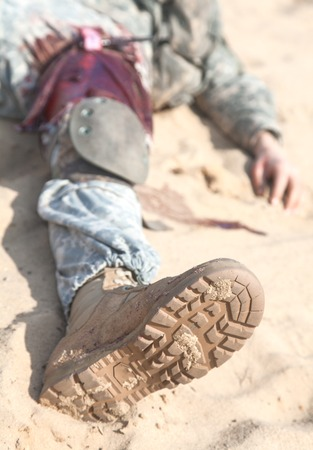Wounded US paratrooper airborne infantrymen in the desert Stock Photo