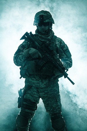 smoke background: United States paratrooper airborne infantry in the smoke