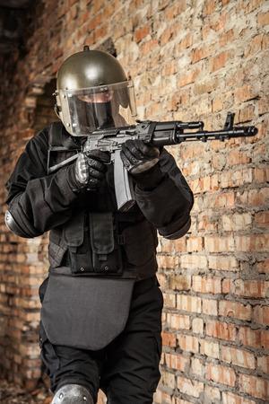 bulletproof: Special forces operator in black uniform and bulletproof