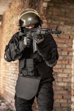 special forces: Special forces operator in black uniform and bulletproof