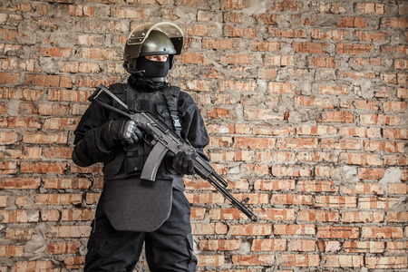 assault forces: Special forces operator in black uniform and bulletproof
