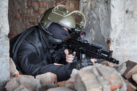 russian federation: Special forces operator in black uniform and bulletproof