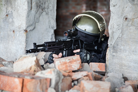 special operations: Special forces operator in black uniform and bulletproof