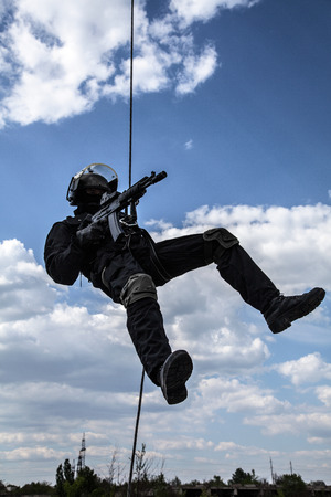 assault: Special forces operator during assault rappeling with weapons