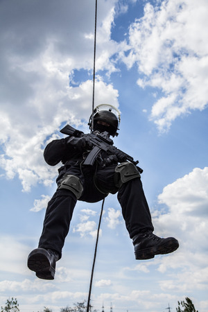 police unit: Special forces operator during assault rappeling with weapons