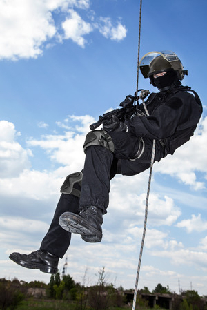 rappeling: Special forces operator during assault rappeling with weapons