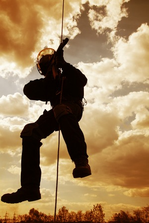special operations: Special forces operator during assault rappeling with weapons