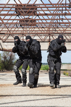 special forces: Special forces operators in black uniform in action