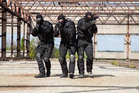 Special forces operators in black uniform in action